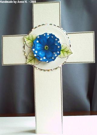 Anne Hart cross blue dotty flowers