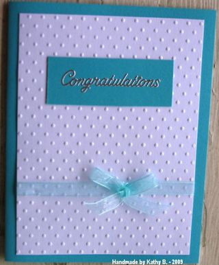 Kathy B Swiss dots on teal graduation