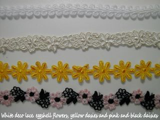 White deco lace, eggshell flowers, yellow daisies n black and pink daisies