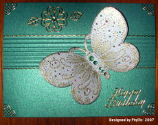 Phyllis_butterfly_on_shimmering_car